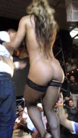 Almost knock out striper woman from the platform